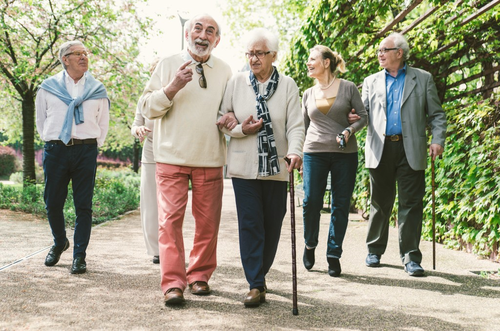 Seniors walking at a park