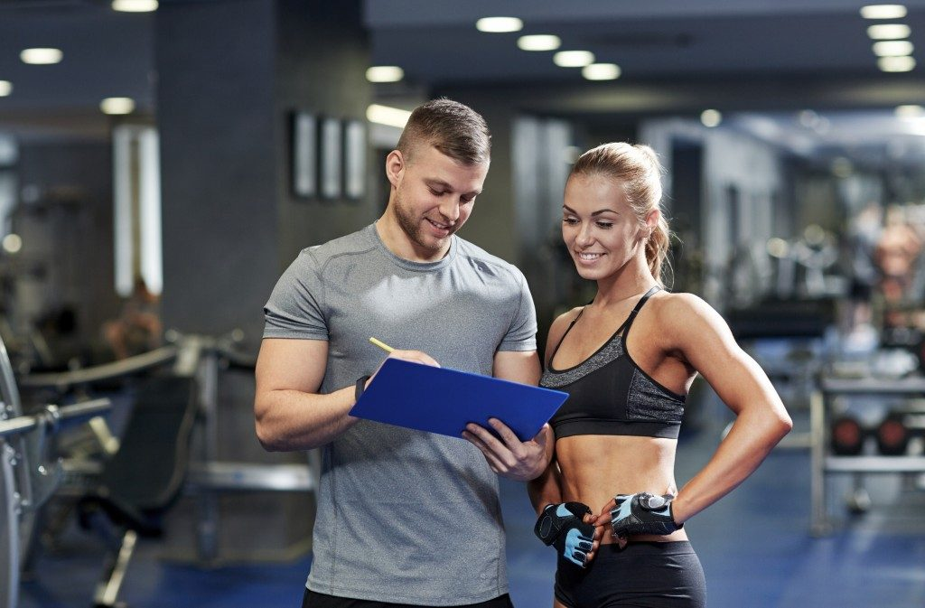 woman consulting with her personal trainer