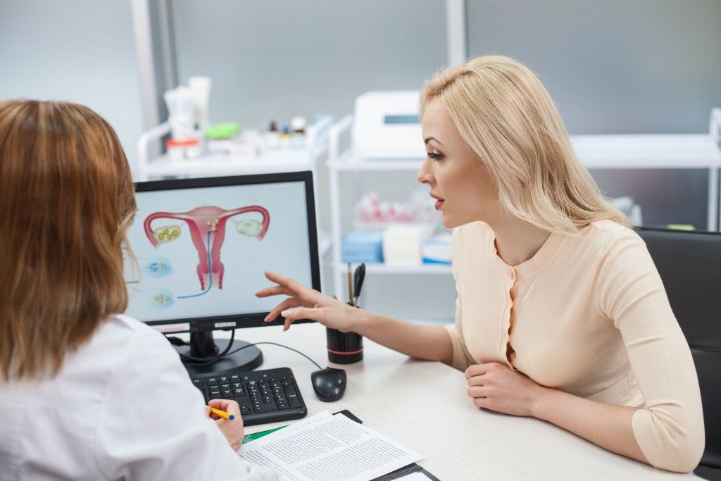 Gynecologist discussing to a patient