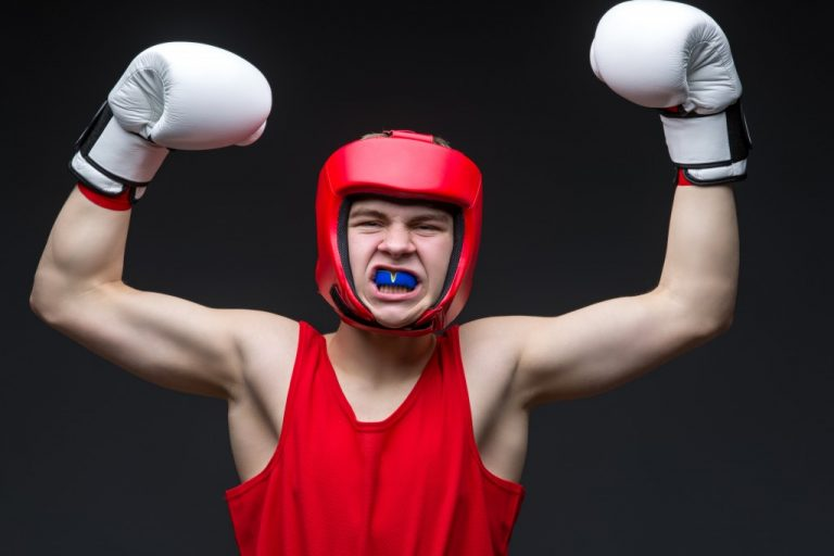 boxer wearing helmet and mouthguard