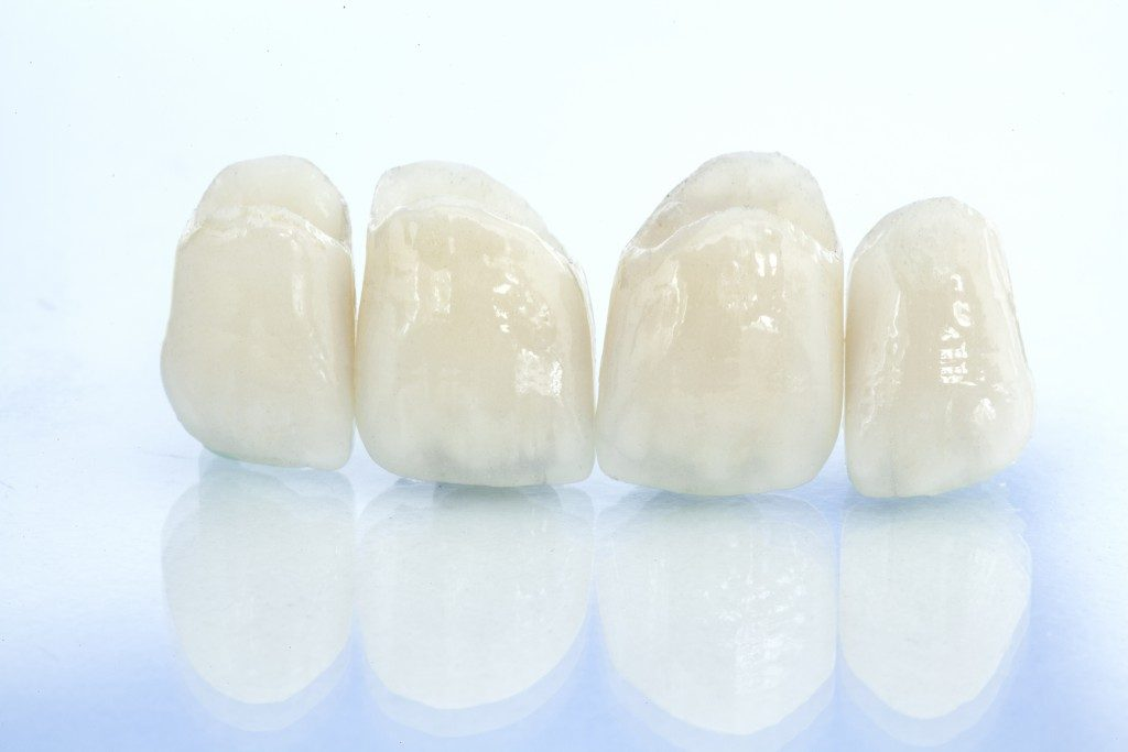 Dental crowns on white background