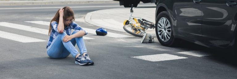 Girl on the floor after car accident