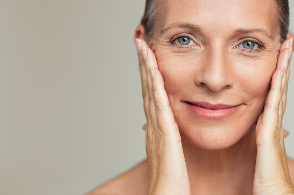 middle aged woman showing her glowing skin