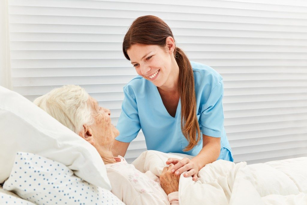 elderly and nurse in a hospice care