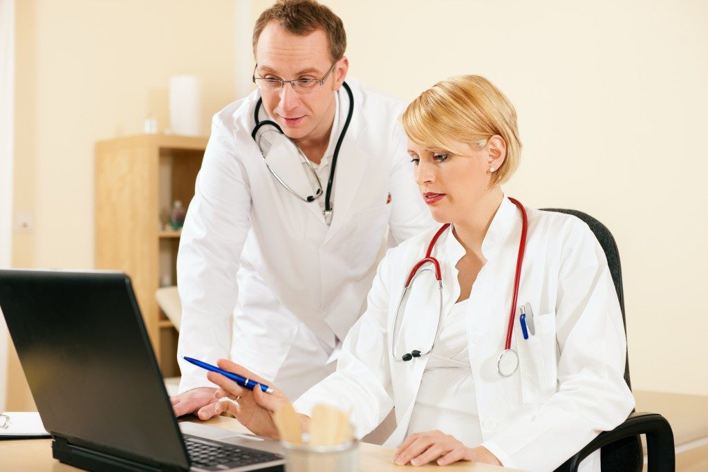 doctors using a laptop