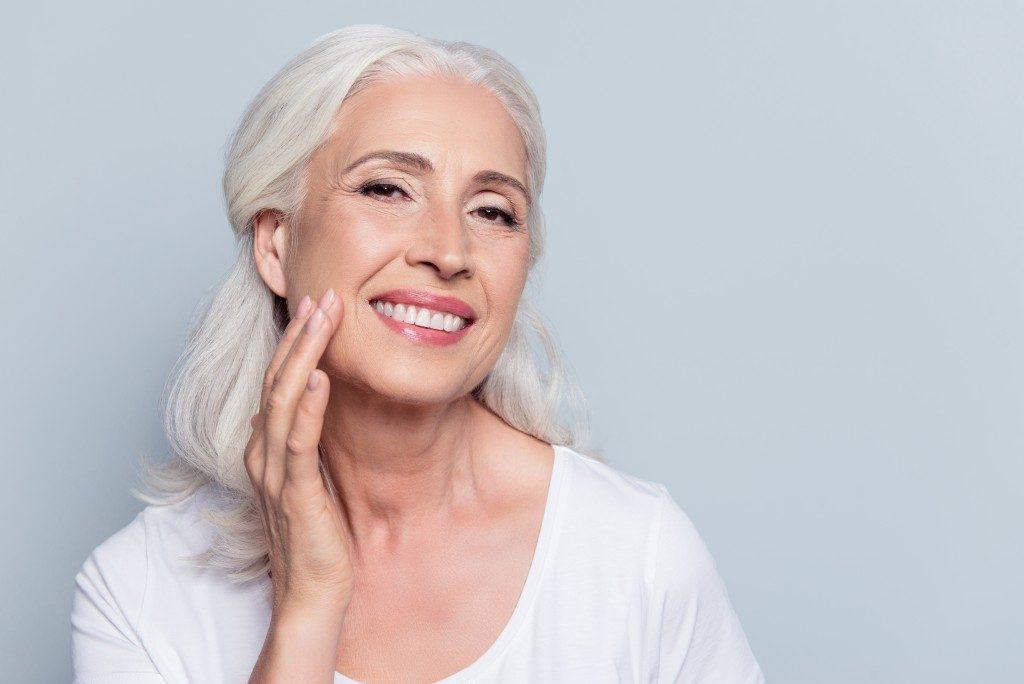 old woman wearing make up