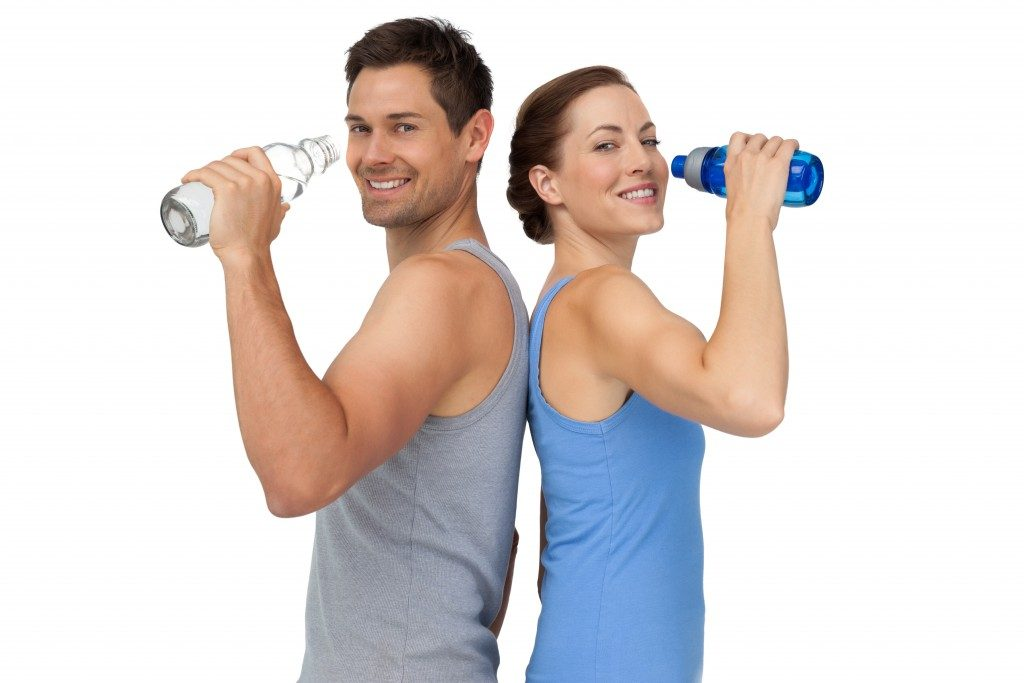 sporty couple drinking water