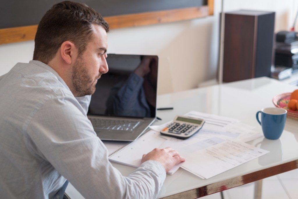 man getting stress while computing bills