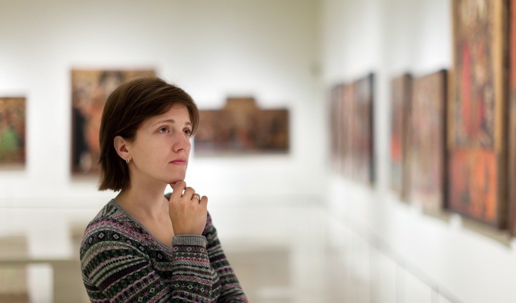 woman looking at art in a museum