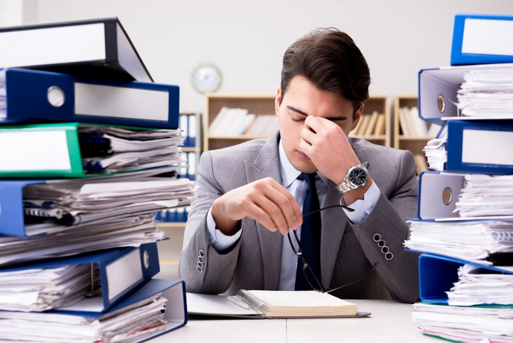man feeling stressed with the workload