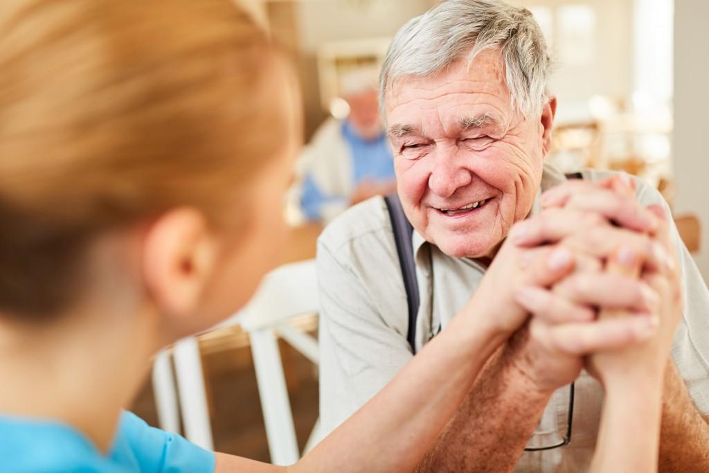 old man speaking to his nurse
