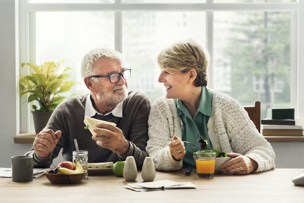 old couple eating together