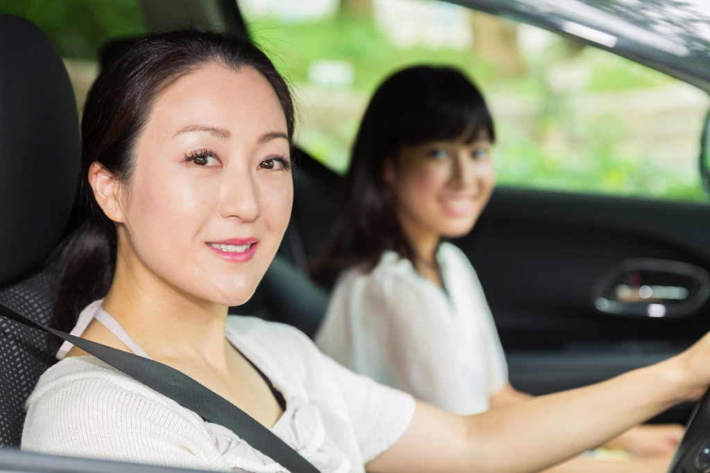 mom driving with child